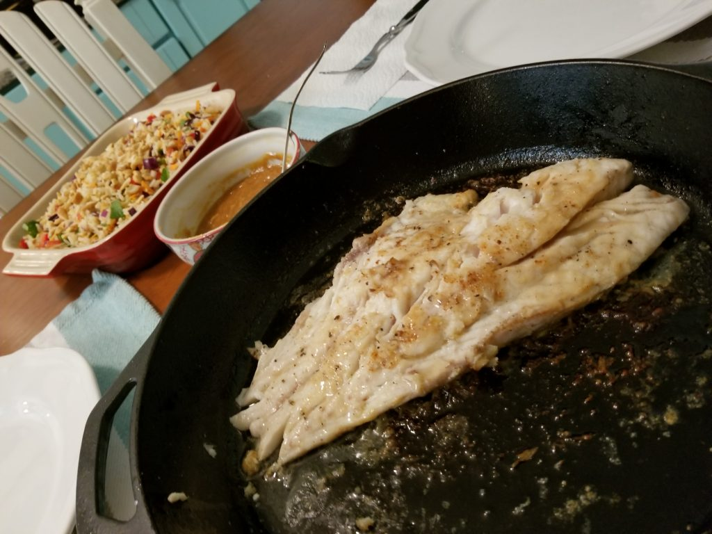 Gag Grouper and Coconut Cashew Rice Salad on teh dinner table
