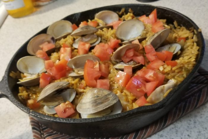 seafood paella in an iron skillet