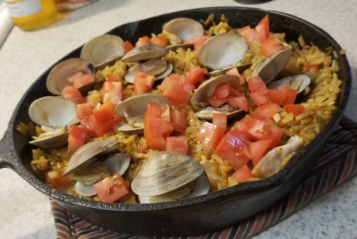 seafood paella in an iron skillet