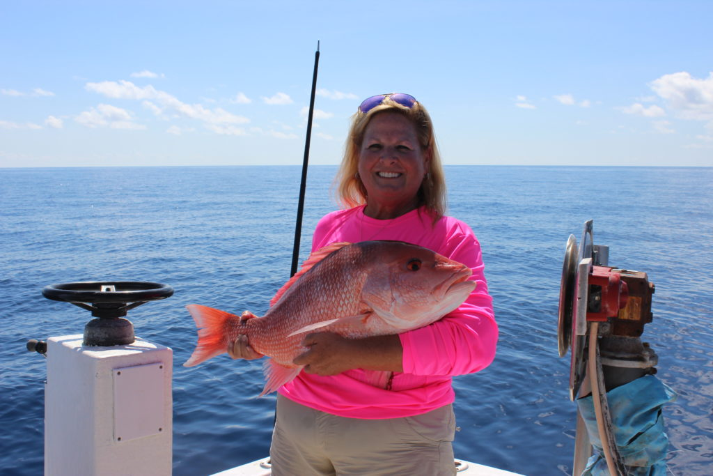 Lora Caddy with her prize American Red Snapper - her first for the 2019 season.