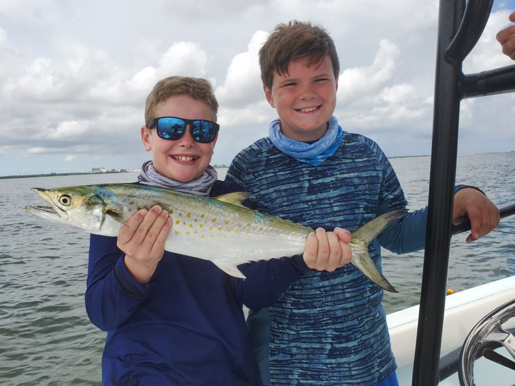 young fellows getting in some late summer fishing on Tampa Bay